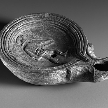 # Lamp, late 1st century b.c.–early 1st century a.d.; Early ImperialRomanTerracotta, mold-madeH. 1 1/4 in. (3.2 cm), Diam. 4 1/8 in. (10.5 cm)The Cesnola Collection, purchased by subscription, 1874–76 (74.51.2027)Source: Lamp <Roman> (74.51.2027) | Heilbrunn Timeline of Art History | The Metropolitan Museum of Art