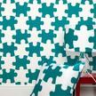На фото: модель Its a puzzle Blue & White wallpaper от фабрики PaperBoy, дизайн Cramsie Victoria.