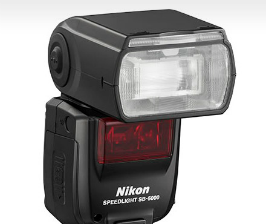 Nikon управляет вспышкой радиоканалом