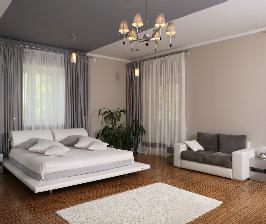 Серо-белая спальня с колоритной каминной зоной: дизайнер Александр Филиппов