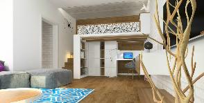 Однокомнатная городская квартира с кроватью на чердаке